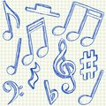 Musical notes doodles on school squared paper Royalty Free Stock Images