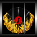 Musical plate and fire on a black background Royalty Free Stock Photography