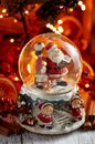 Musical Snow Globe with Santa Claus on bokeh background Royalty Free Stock Photo