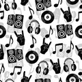 Musical vector background, music accessories seamless pattern. Silhouette drawing black and white  headphones, disk CD, plate, lou Royalty Free Stock Photo