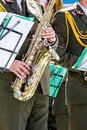 Musician of military orchestra plays saxophone Royalty Free Stock Photo