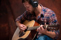 Musician playing acoustic guitar close up of a male Royalty Free Stock Photo