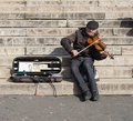 Musician Playing a Violin For Money Royalty Free Stock Photo