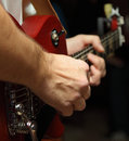 Musician s hands a playing guitar fragment Royalty Free Stock Photo