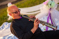 Musician trumpeter playing the instrument at sunset Royalty Free Stock Image
