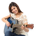 Musician woman playing guitar in a course isolated on white background Stock Image
