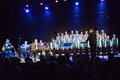 Musicians and boys choir onstage Royalty Free Stock Photo