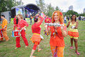Musicians in bright costumes at festival moscow august ekofest on banks of stroginsky gulf on august moscow russia Royalty Free Stock Photo