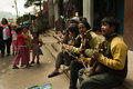 Musicians a group of local are performing to attract tourists at darjeeling mall india for earning tips Stock Photos
