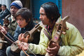 Musicians a group of local are performing to attract tourists at darjeeling mall india for earning tips Stock Photo