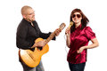 Musicians smiling couple plays guitar and sings on white background Stock Photo