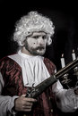 Musket and candle gentleman rococo era wig man dressed in vintage Royalty Free Stock Photography