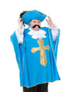 Musketeer in turquoise blue uniform cavalier gentleman feathered cap and of the cross with over a rotund fat belly isolated on Royalty Free Stock Photo