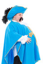 Musketeer in turquoise blue uniform cavalier gentleman feathered cap and of the cross with over a rotund fat belly isolated on Royalty Free Stock Image