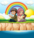 Muslim boy and girl reading book Royalty Free Stock Photo