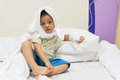 Muslim boy with headwear and IV solution Royalty Free Stock Photo