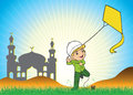Muslim boy playing a kite in the field Royalty Free Stock Photos