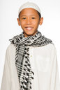 Muslim boy wearing islamic attire Stock Images