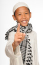 Muslim boy wearing islamic attire Stock Photos