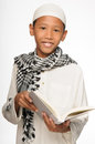 Muslim boy wearing islamic attire Royalty Free Stock Photos