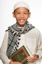 Muslim boy wearing islamic attire Royalty Free Stock Image