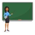 Muslim or Brazilian looking woman teacher standing in front of blackboard teaching student in classroom at school