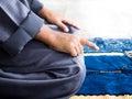 Muslim child praying for Allah