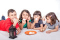 Muslim Children eating Kahk - Kaak ( Cookies ) in the feast Royalty Free Stock Photo