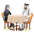 Muslim couple sit together at the table together