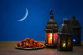 The Muslim feast of the holy month of Ramadan Kareem. Beautiful background with a shining lantern Fanus