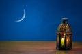 The Muslim feast of the holy month of Ramadan Kareem. Beautiful background with a shining lantern Fanus.