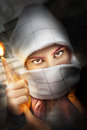 Muslim fire in hand. Cosplayer. Woman with her face covered Royalty Free Stock Photo
