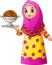 Muslim girl wearing pink veil with holding a platter of cake