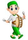 Muslim kid playing mini drum on the month of ramadan