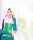 Muslim kid student thinking portrait holding books something Stock Photo