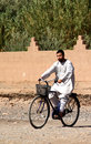 Muslim man on a bicycle Royalty Free Stock Photo