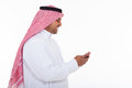 Muslim man cell phone side view of cheerful in traditional clothes using Stock Photos