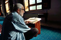 Muslim man reading the Holy Qur'an Royalty Free Stock Photo