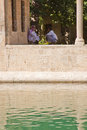 Muslim men at holy lake sanliurfa turkey august unidentified sit beside with sacred fish of golbasi park and halil rahman mosque Stock Images