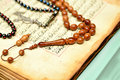 Muslim rosary beads on the holy quran years an ancient hand scripted with prayer Stock Photography