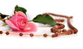 Muslim rosary and pink rose on a white background islamic prayer beads Stock Photo