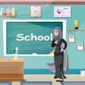 Muslim teacher, professor standing in front of blackboard Royalty Free Stock Photo
