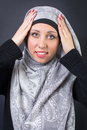 Muslim woman adjusting her headscarf beautiful religious Royalty Free Stock Photography