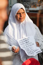 Muslim woman begs on street sarajevo bosnia and herzegovina aug holds note and august in sarajevo b h she collects money for Royalty Free Stock Images