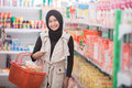 Muslim woman buying some halal product