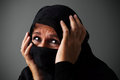 Muslim woman in distress middle aged wearing the niqab Stock Photos
