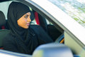 Muslim woman driving attractive young a car Royalty Free Stock Images