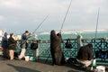 Muslim woman fishing at evening Royalty Free Stock Photo