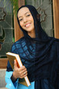 Muslim Woman  Holding Qur'an Stock Photos