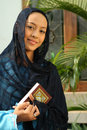 Muslim Woman at the Mosque Holding Qur'an Stock Image